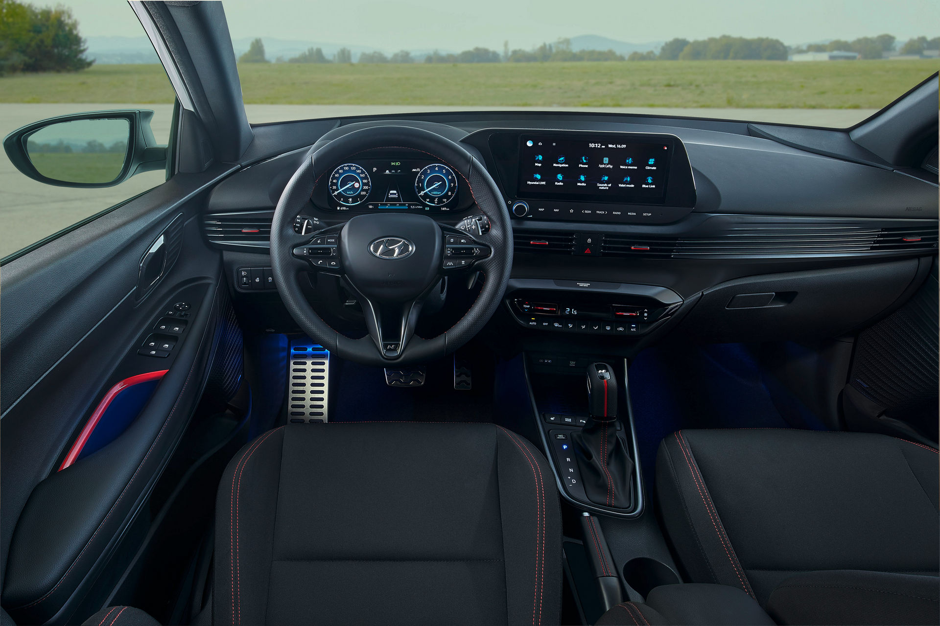 All-black interior with new 3-spoke steering wheel