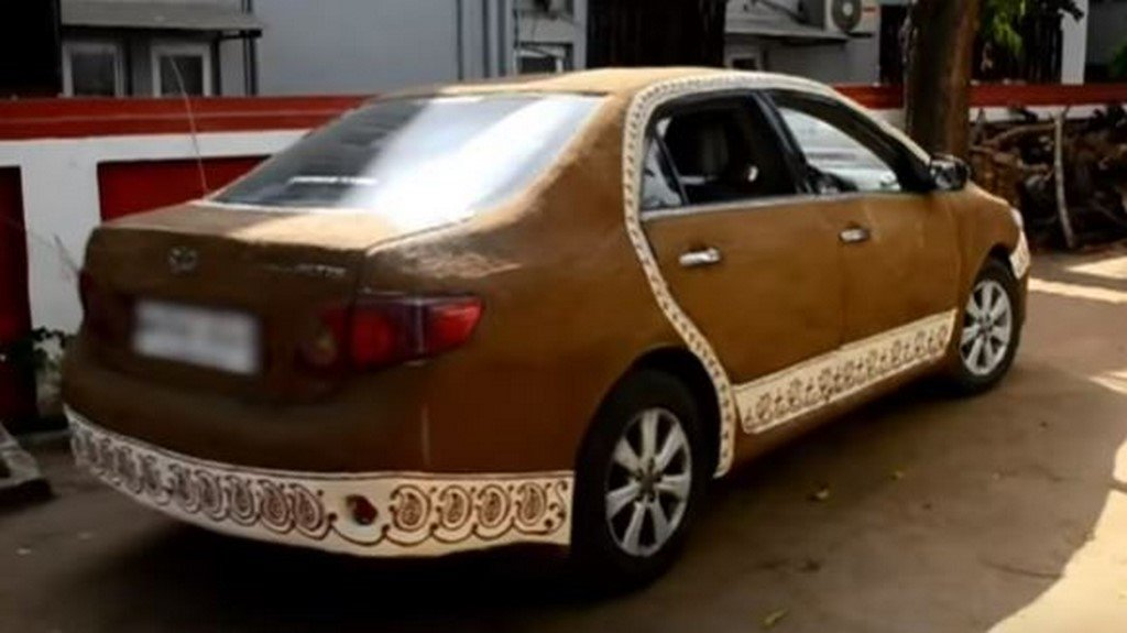 Toyota Corolla In Cow Dung Rear